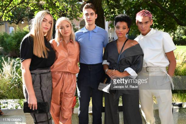 Mercy Fiennes-Tiffin, Pom Klementieff, Hero Fiennes-Tiffin, Kiersey Clemons and Evan Mock attends the Salvatore Ferragamo show during Milan Fashion...