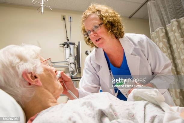 Mercy Hospital ER nurse Katie Johnson takes Sister Margaret Cushmans temperature in the State Street emergency room on Wednesday August 16 2017 The...