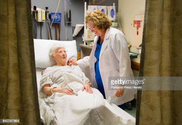 Mercy Hospital ER nurse Katie Johnson treats Sister Margaret Cushman at the State Street emergency room on Wednesday August 16 2017 The city of...