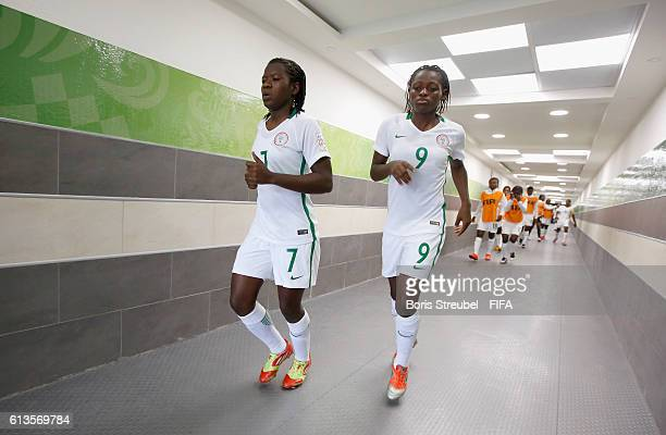 Mercy Omokwo and Peace Efih of Korea DPR enter the pitch though the players tunnel during the FIFA U17 Women's World Cup Group C match between Korea...