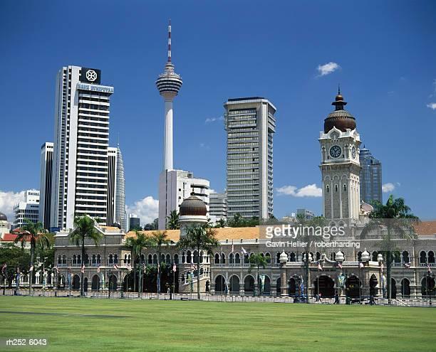 merdaka square including the sultan abdul samad building and the petronas towers, kuala lumpur, malaysia, asia - menara kuala lumpur tower stock photos and pictures