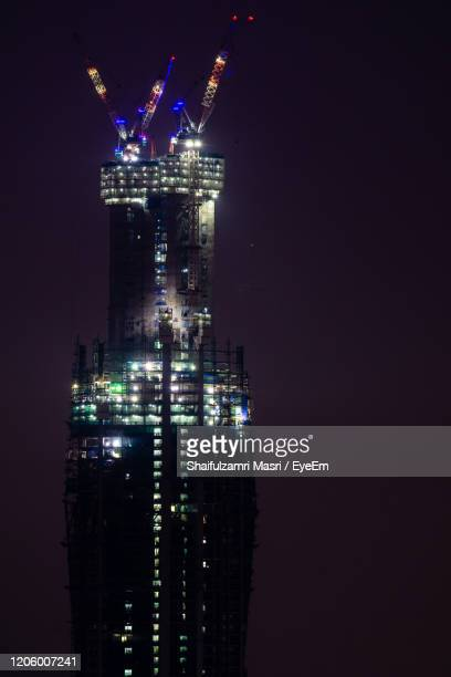 merdeka pnb 118 is a 118 floors megatall skyscraper currently being built in kuala lumpur, malaysia. - shaifulzamri stock pictures, royalty-free photos & images