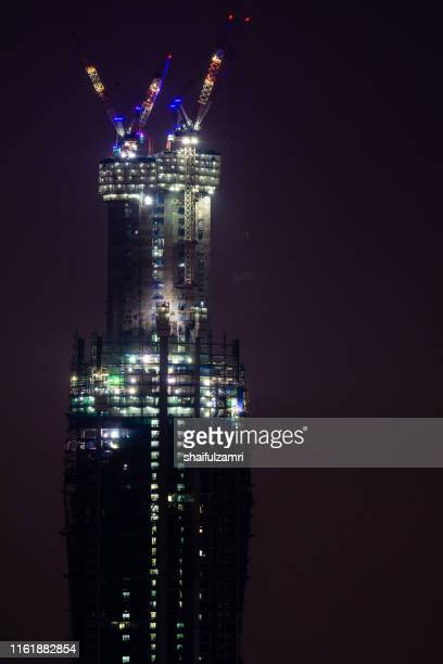 merdeka pnb 118 or menara warisan which is its formerly used name, is a 118 floors megatall skyscraper currently being built in kuala lumpur, malaysia. - shaifulzamri stock pictures, royalty-free photos & images