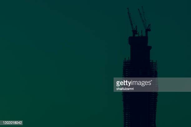 merdeka118 is a 118-story, 644-metre mega tall skyscraper currently under construction in kuala lumpur, malaysia. - shaifulzamri stock pictures, royalty-free photos & images