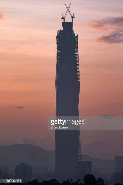 merdeka118 is a 118-story, 644-metre mega tall skyscraper currently under construction in kuala lumpur, malaysia - shaifulzamri stock pictures, royalty-free photos & images