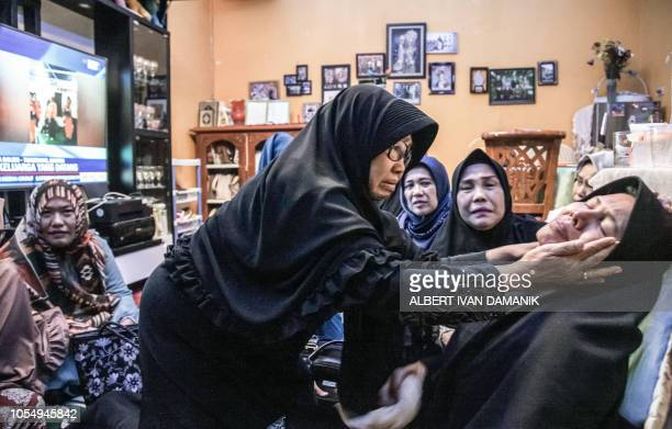 TOPSHOT Merdiana Harahap is consoled for the loss of her husband a passenger on board the illfated Lion Air flight JT 610 in Medan North Sumatra...