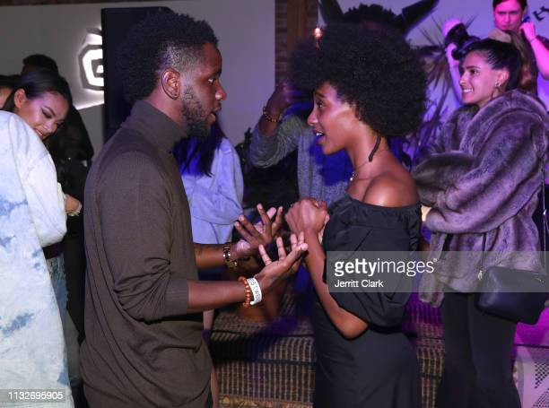 Mereba poses with guests at Mereba's Album Listening Party And Performance Celebrating The Jungle Is The Only Way Out at Urban Outfitters Space 15...