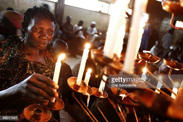 Mereciana Nantavo of Mbale Uganda lights a candle at the Catholic Basilica Church of the Uganda Martyrs a day before the Ugandan national Martyrs Day...