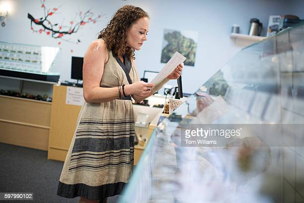 Meredith Bower checks out the inventory of medical marijuana at the Takoma Wellness Center in Takoma Park August 30 2016 Bower suffers from phantom...