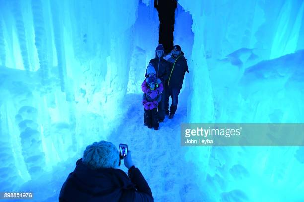 Meredith Fox takes a photo of Lennon Miano Hannah Bea Miano Carrie Miano and Matt Miano as they check out the Ice Castle preview at Dillon Town Park...