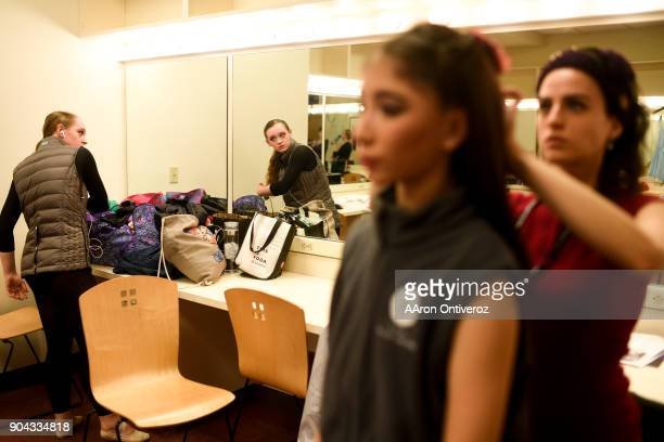 Meredith Hardin gets ready as she looks in the mirror while Maria Chavez gets her hair done by teacher Marta Katz during the 2018 Youth America Grand...