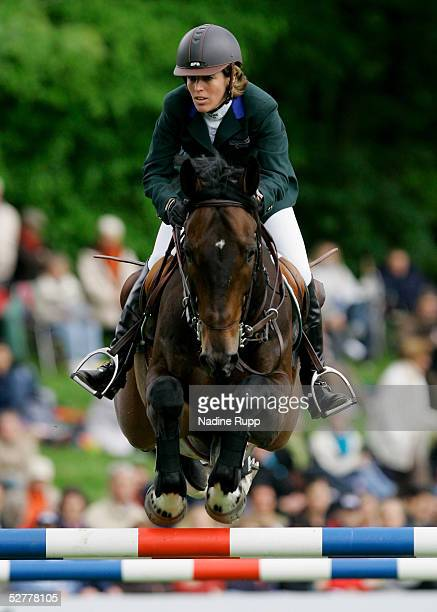 Meredith Michaels Beerbaum of Germany jumps on her horse Checkmate during the Hasseroeder championship of Hamburg of the German Jumping and Dressage...