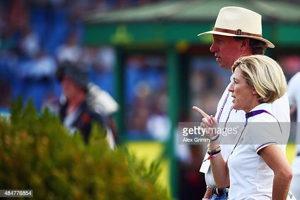 Meredith MichaelsBeerbaum and her husband Markus Beerbaum of Germany inspect the course prior to the second round of the MercedesBenz Prize Show...