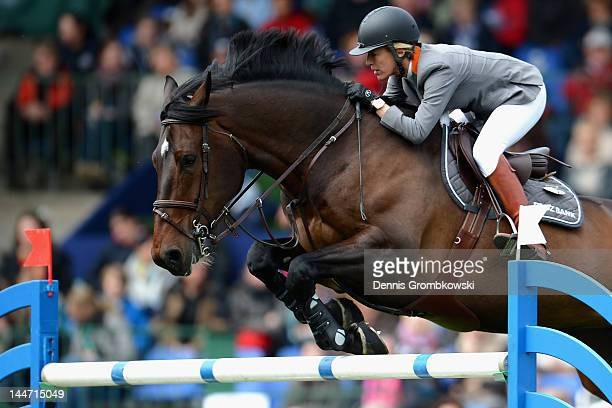 Meredith MichaelsBeerbaum of Germany and Bella Donna compete in the CSI5 jumping competition against the clock during day two of the German Jumping...