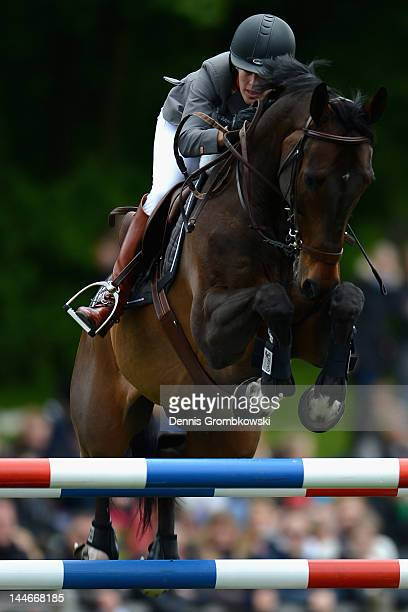 Meredith MichaelsBeerbaum of Germany and Checkmate IV compete in the MercedesBenz Championat of Hamburg during day one of the German Jumping Dressage...