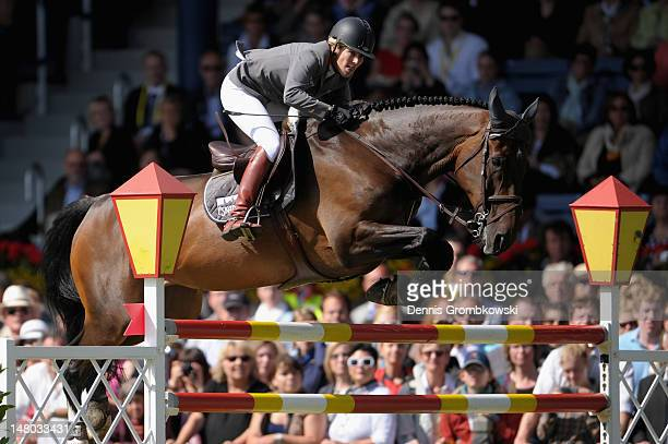 Meredith MichaelsBeerbaum of Germany and her horse Bella Donna 66 compete in the Rolex Grand Prix jumping competition during day six of the 2012 CHIO...