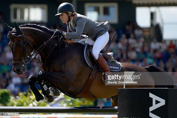 Meredith MichaelsBeerbaum of Germany and her horse Checkmate 4 compete in the Prize of AachenMuenchener jumping competition during day five of the...