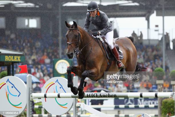 Meredith MichaelsBeerbaum of Germany clears a jump on her horse Shutterfly during the Warsteiner jumping competition at the CHIO on July 13 2011 in...