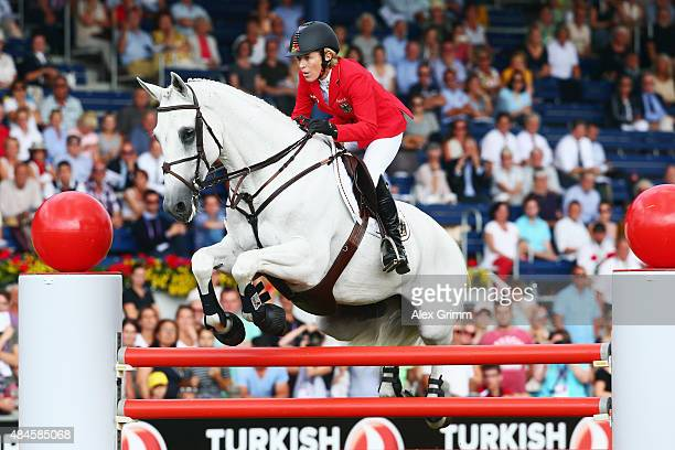 Meredith MichaelsBeerbaum of Germany competes on her horse Fibonacci 17 during the MercedesBenz Prize Team Show Jumping competition on Day 9 of the...