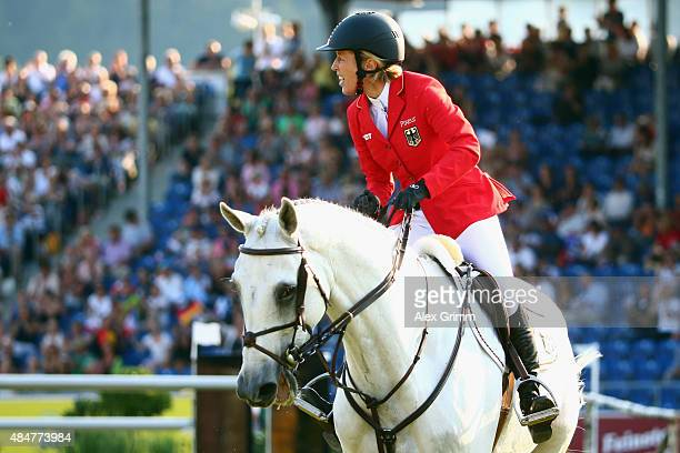 Meredith MichaelsBeerbaum of Germany competes on her horse Fibonacci 17 during the second round of the MercedesBenz Prize Show Jumping team...