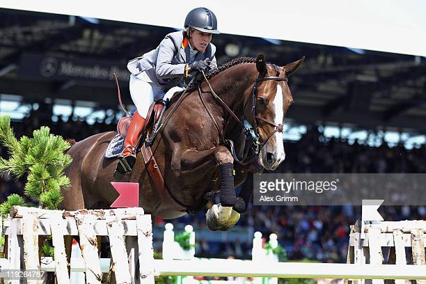 Meredith MichaelsBeerbaum of Germany competes on her horse Kismet during the 'RWE Preis of NordrheinWestfalen' jumping competition at the CHIO on...