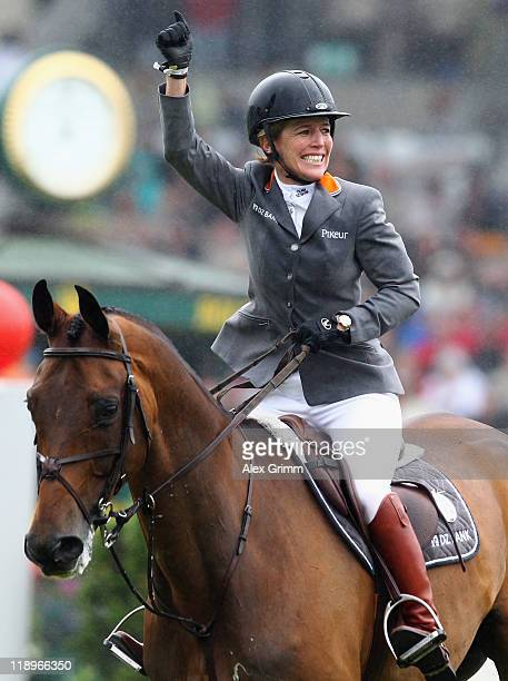 Meredith MichaelsBeerbaum of Germany on her horse Shutterfly celebrates after winning the Warsteiner jumping competition at the CHIO on July 13 2011...
