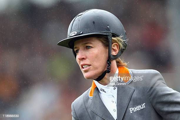 Meredith MichaelsBeerbaum of Germany on her horse Shutterfly reacts during the Warsteiner jumping competition at the CHIO on July 13 2011 in Aachen...