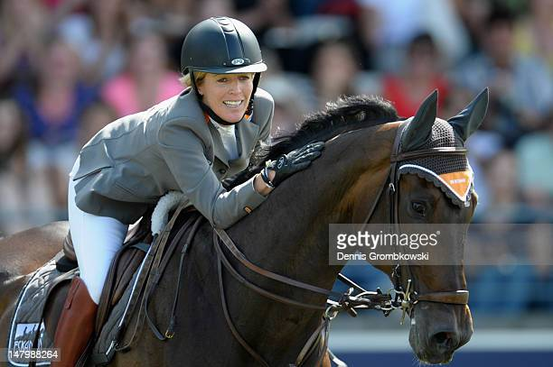 Meredith MichaelsBeerbaum of Germany pets her horse Checkmate 4 during the Prize of AachenMuenchener jumping competition during day five of the 2012...