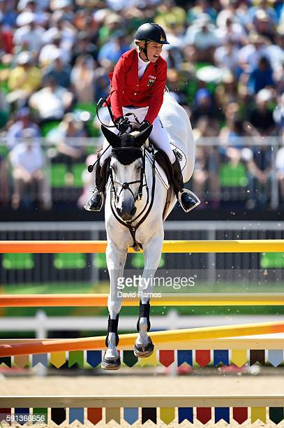 Meredith Michaels-Beerbaum of Germany rides Fibonacci during the Jumping Team Round 2 during Day 12 of the Rio 2016 Olympic Games at the Olympic...