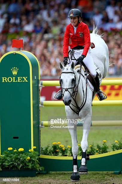 Meredith MichaelsBeerbaum of Germany rides on Fibonacci during the Rolex European Champion jumping competition on Day 12 of the FEI European...