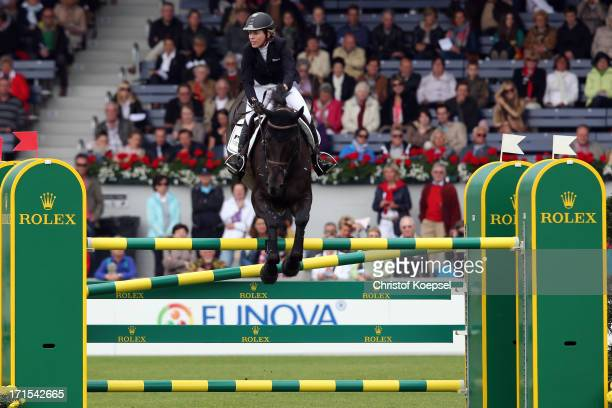 Meredith MichaelsBeerbaum of Germany rides on Unbelievable 5 during the Warsteiner Price jumping competition during day two of the 2013 CHIO Aachen...