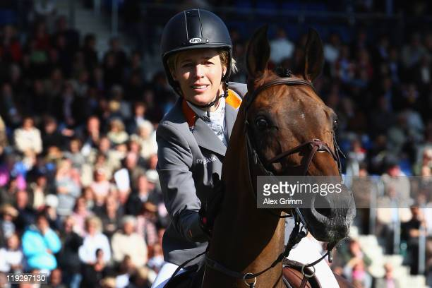 Meredith MichaelsBeerbaum of Germany teases her horse Shutterfly during a farewell ceremony at the CHIO on July 17 2011 in Aachen Germany