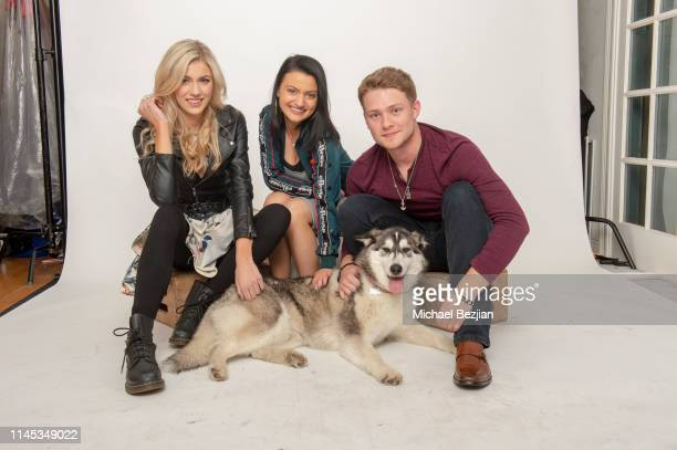 Meredith Vancuyk Laci Mercede and Lou Wegner with Luna the Husky of Kids Against Animal Cruelty pose for a portrait at Giveback Day at TAP The...