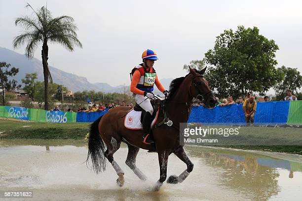 Merel Blom of the Netherlands riding Rumour Has It competes during the Cross Country Eventing on Day 3 of the Rio 2016 Olympic Games at the Olympic...