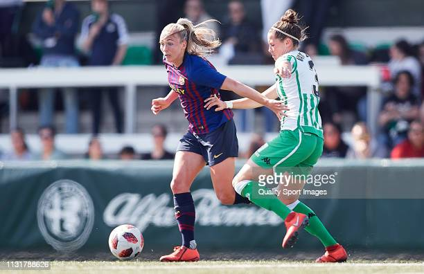 Merel Didi Van Dongen of Real Betis competes for the ball with Toni Duggan of FC Barcelona during the La Liga Iberdrola first division match between...