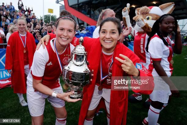 Merel van Dongen of Ajax Women Ana Romero of Ajax Women celebrates the championship with the trophy during the Dutch KNVB Beker Women match between...