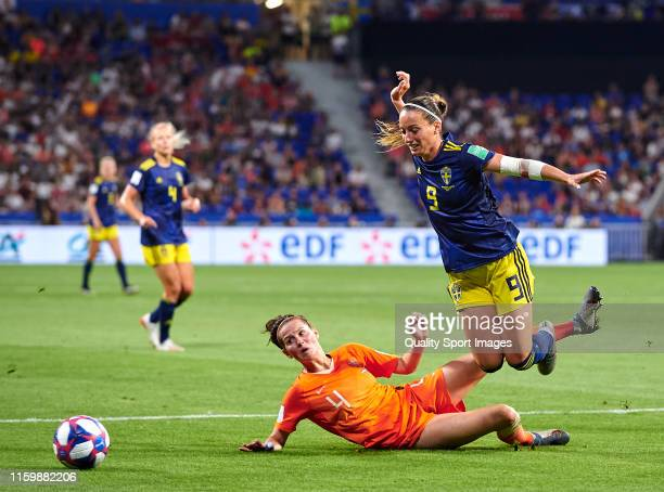 Merel Van Dongen of Netherlands competes for the ball with Kosovare Asllani of Sweden during the 2019 FIFA Women's World Cup France Semi Final match...