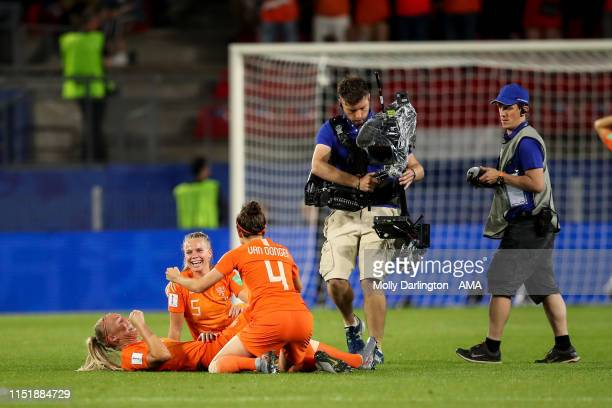 Merel Van Dongen of the Netherlands and Kika Van Es of the Netherlands celebrate at full time during the 2019 FIFA Women's World Cup France Round Of...
