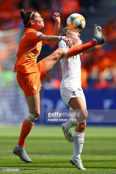 Merel Van Dongen of the Netherlands battles for possession with Paige Satchell of New Zealand during the 2019 FIFA Women's World Cup France group E...