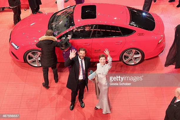 Meret Becker and Alexander Beyer arrive for 'The Grand Budapest Hotel' Premiere and opening ceremony in a Audi car during the 64th Berlinale...