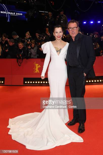"""Meret Becker and Sebastian Koch arrive for the opening ceremony and """"My Salinger Year"""" premiere during the 70th Berlinale International Film Festival..."""
