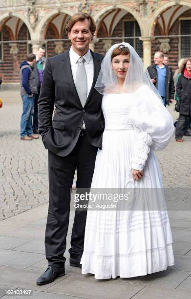 Meret Becker and Thomas Heinze attend a photocall for Luegen in front the Town Hall of Bremen on April 12 2013 in Bremen Germany