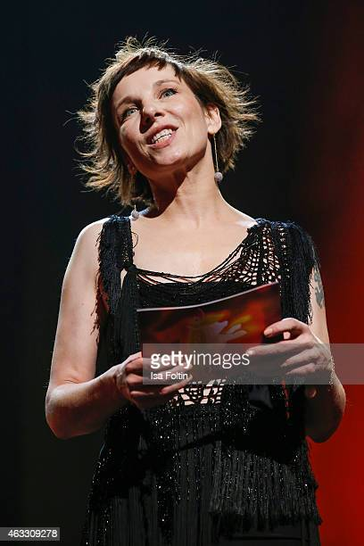 Meret Becker attend the Honorary Golden Bear award for Wim Wenders during the 65th Berlinale International Film Festival at Berlinale Palace on...