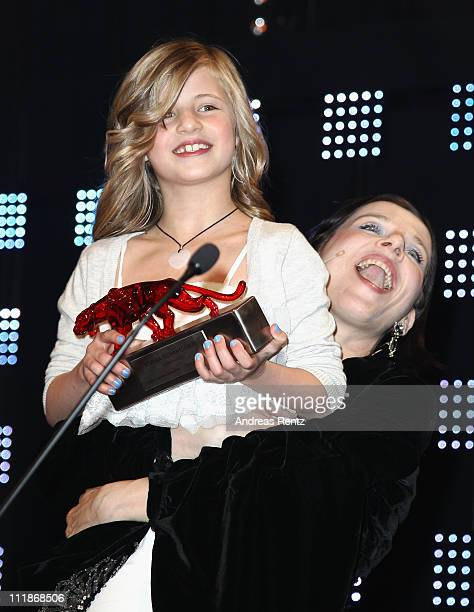 Meret Becker lifts up Emma Schweiger with her award during the 'new faces award' 2011 at the bcc on April 7 2011 in Berlin Germany