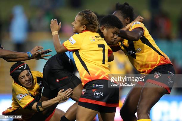 Merewairita Nai of Fiji is tackled during the Women's Pacific International Test Match between Fiji and Papua New Guinea at Leichhardt Oval on June...