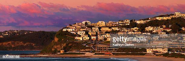 Merewether beach with houses on cliff