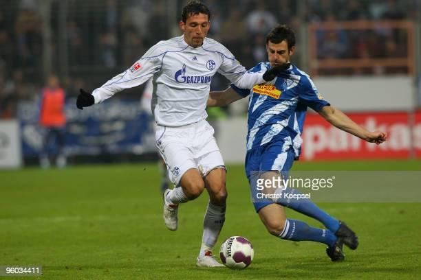 Mergim Mavraj of Bochum tackles Kevin Kuranyi of Schalke during the Bundesliga match between VfL Bochum and FC Schalke 04 at Rewirpower Stadium on...