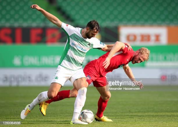 Mergim Mavraj of Greuther tackles Sebastian Griesbeck of Heidenheim during the Second Bundesliga match between SpVgg Greuther Fürth and 1. FC...