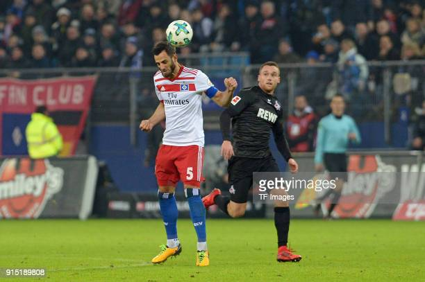 Mergim Mavraj of Hamburg and Christian Clemens of Koeln battle for the ball during the Bundesliga match between Hamburger SV and 1 FC Koeln at...