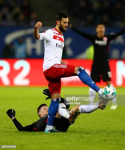 Mergim Mavraj of Hamburg and Luka Jovic of Frankfurt battle for the during the Bundesliga match between Hamburger SV and Eintracht Frankfurt at...